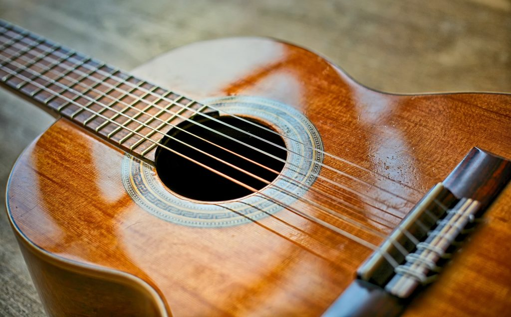 Classical guitar close shot of strings and sound hole